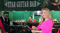 Evelyn cuts ribbon for Star Guitar Bar